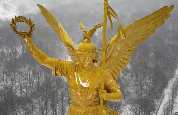 The Golden Victoria statue atop of the Siegessaeule (victory column) is pictured on a snowy day in Berlin.