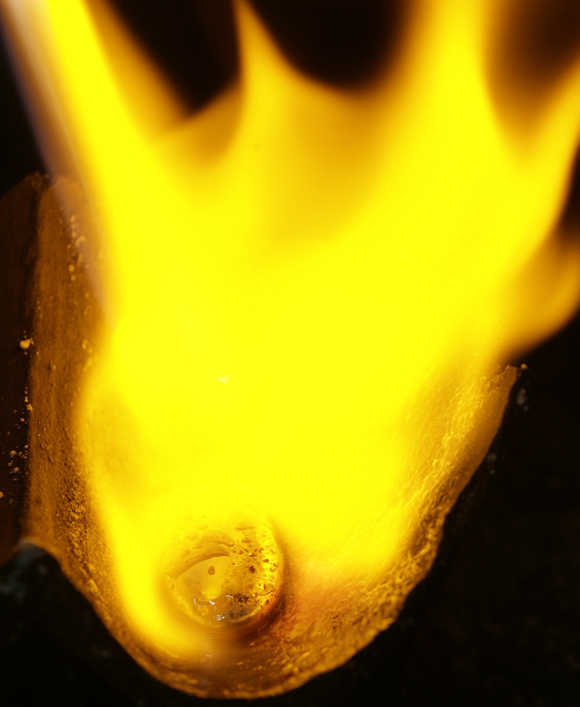 A gold chip is torched at a gold jewellery factory in Meycauayan, Bulacan, north of Manila.
