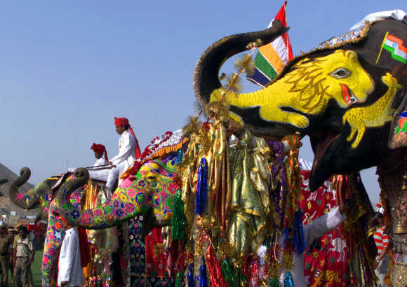 Mahouts sit on decorated elephants during a competition of the Elephant Festival in Jaipur.