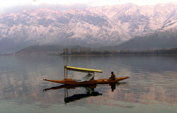 A Kashmiri man paddles his boat at Dal Lake in Srinagar.