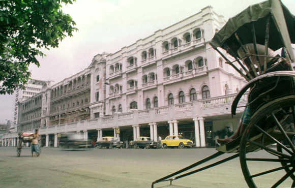 A rickshaw stands outside the Grand Hotel in Kolkata.