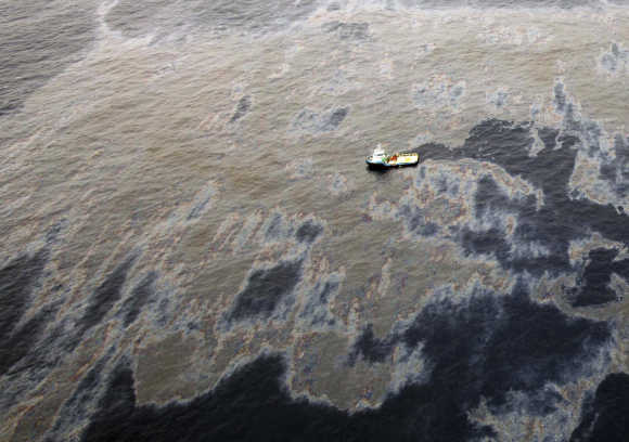 An aerial view shows oil that seeped from a well operated by Chevron at Frade, on the waters in Campos Basin in Rio de Janeiro, Brazil.
