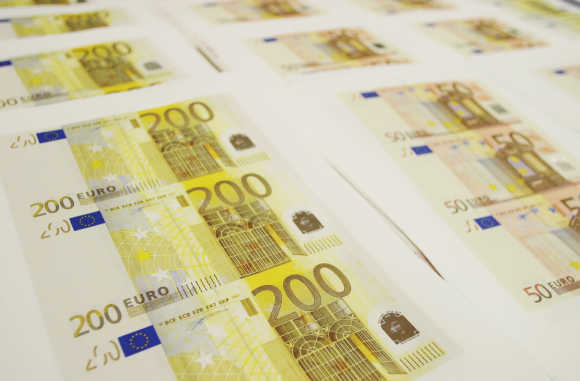 Counterfeit euro notes are shown at a Spanish police station in Madrid.