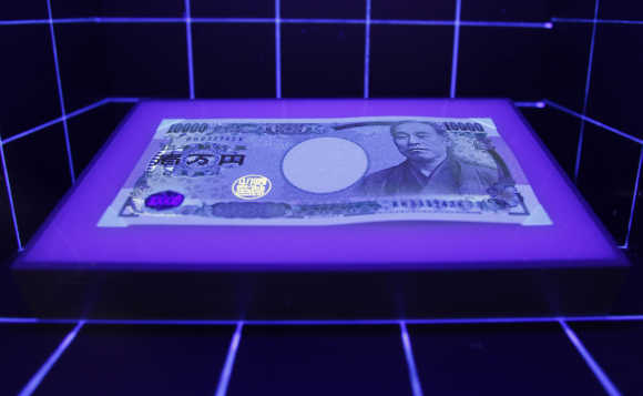 A 10,000 yen is displayed under a light at the currency museum of the Bank of Japan in Tokyo.