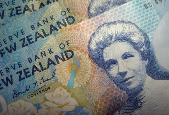 Reserve Bank of New Zealand dollar notes are pictured in Singapore.