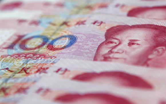 Chinese 100 yuan banknotes are seen in Shanghai.