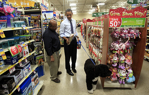 US President Barack Obama buys a bone for his dog Bo (R) in Alexandria, Virginia.