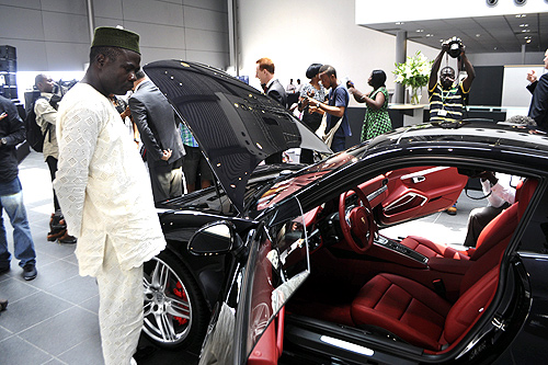 A Nigerian man looks at a vehicle by German carmaker Porsche in Lagos.