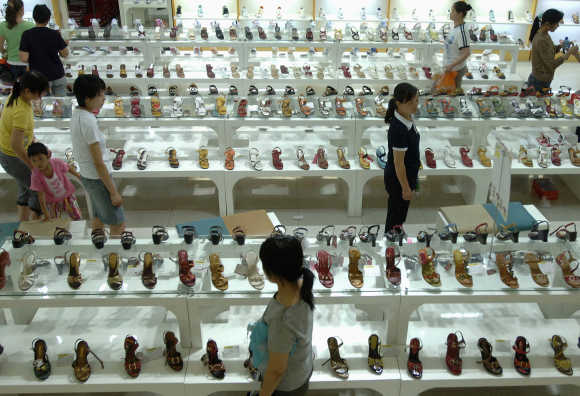 Customers look for shoes at a market in Hefei, east China's Anhui province.