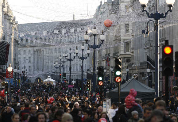 Shoppers fill Regent Street in central London.