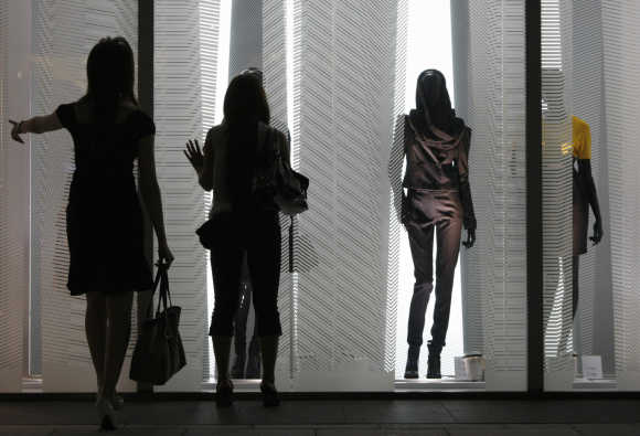 Women look at displays in a H&M store in Tokyo's Ginza shopping district.