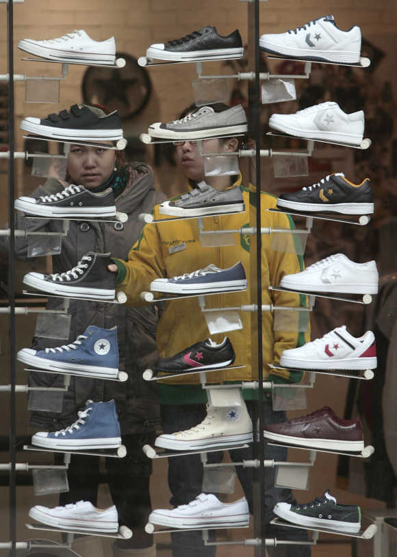 Consumers look at shoes on display at a shop in Nanjing, Jiangsu province, China.