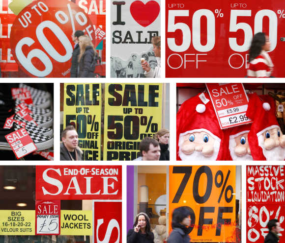 A combination of nine photographs shows a variety of sale signs in Oxford Street, central London.