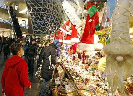 Christmas shoppers walk through Zlote Tarasy Shopping Mall in Warsaw.