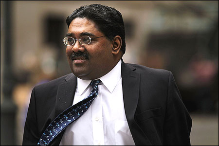 Billionaire Galleon Group hedge fund co-founder Raj Rajaratnam enters a Manhattan Federal Court.