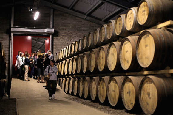 Tourists pay a visit to Edradour distillery.