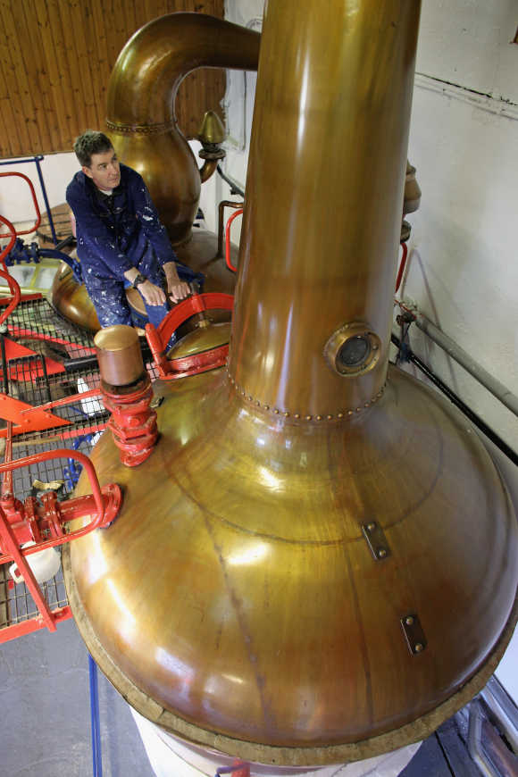 Jimmy Kennedy works on a copper still at Edradour distillery.