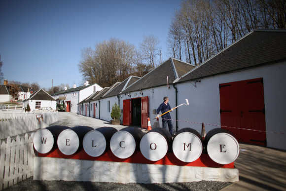 Jimmy Kennedy paints a wall at Edradour distillery.