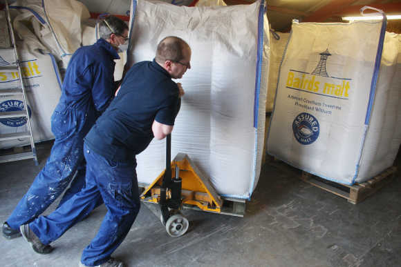 Jimmy Kennedy and Bose Mathias bring in a delivery of malt at Edradour distillery.