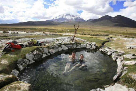 Newlyweds Bart Swaan, left, and Greet Oostvogels, right, from Belgium, take a bath in a hotspring in the Sajama national park, one of 22 natural reserves in Bolivia, located some 250km southwest of La Paz, Bolivia.
