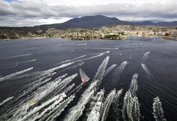 Australian supermaxi Wild Oats XI, centre, approaches the finish line at Hobart during the annual Sydney to Hobart yacht race.
