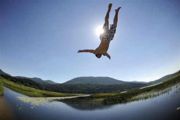 A boy jumps into Lake Cerknica in Slovenia.