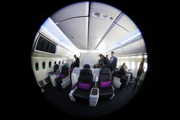People view the interior of the Dreamliner.
