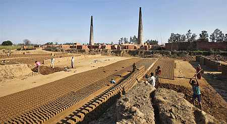 Labourers work in a brick factory at Libbar Hari in Uttarakhand