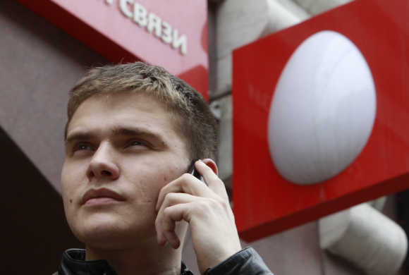 A man speaks on a mobile phone near an office of Russia's mobile phone operator MTS in Moscow.