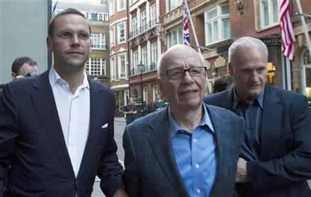 James Murdoch (L), his father Rupert (C)