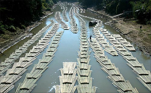 Bamboo logs are transported down the river Longai near Kanmun village, about 235 km (146 miles) west from Aizawl, Mizoram's capital city.