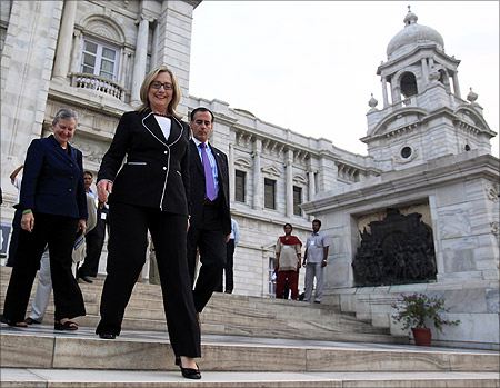 US Secretary of State Hillary Clinton (2nd L) walks down the steps of Victoria Memorial Hall in Kolkata.