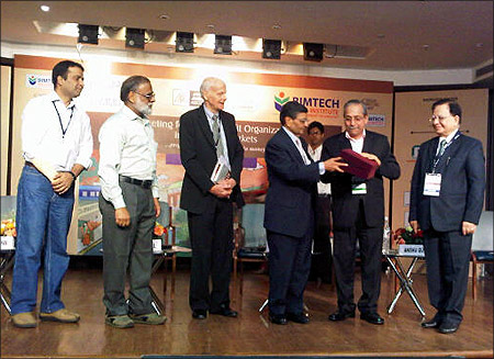 Dr Jagdish Sheth (3rd from right, receives a momento from Dr. H. Chaturvedi, Director BIMTEC.