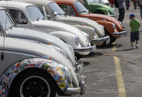 A child passes a row of Beetle cars during the 29th annual May Beetle meeting in Hanover.