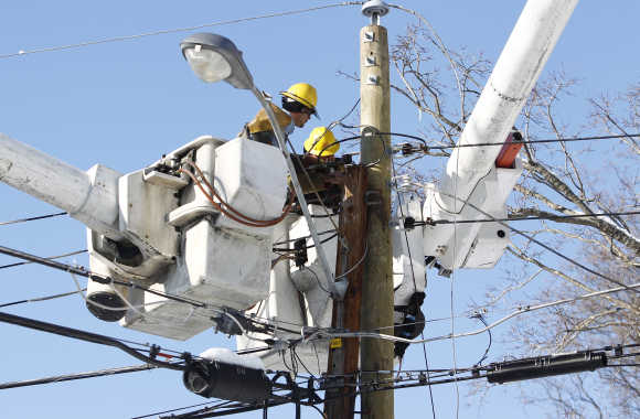 Utility workers attempt to restore power to residents in Falls Church, Virginia, US.