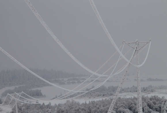Electric wires are covered in ice near the village of Skala, about 20km north of Krakow, Poland.