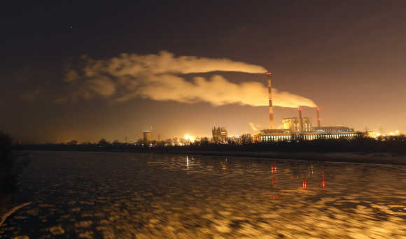Pieces of ice flow on Vistula River next to the Zeran Heat Power Station in the Bialoleka suburb of Warsaw, Poland.