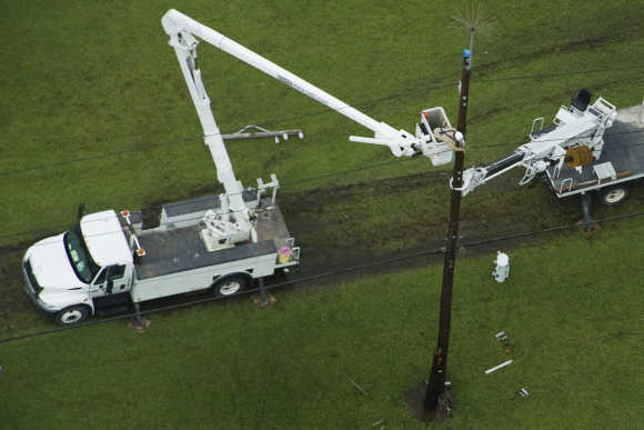 Power crews work on lines in Port Arthur, Texas.