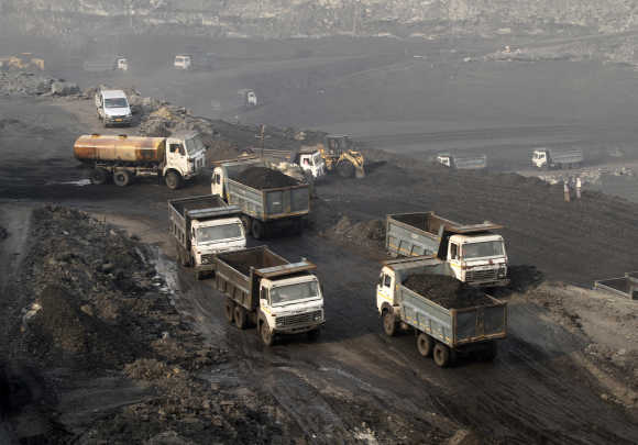 Trucks move in the Mahanadi coal fields, near Talcher town, Orissa.
