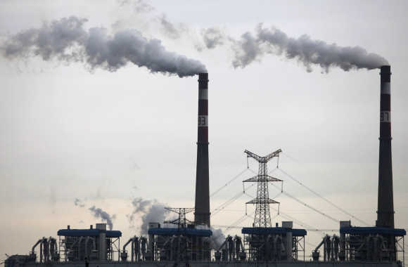 Smoke billows from chimneys of a coal-burning power plant in Wuhan, China.