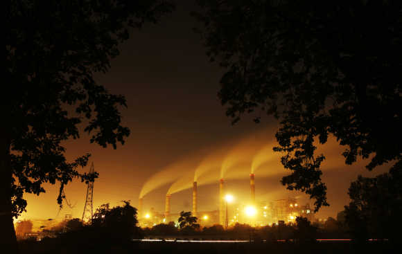A thermal power station is seen through trees in Nagpur.
