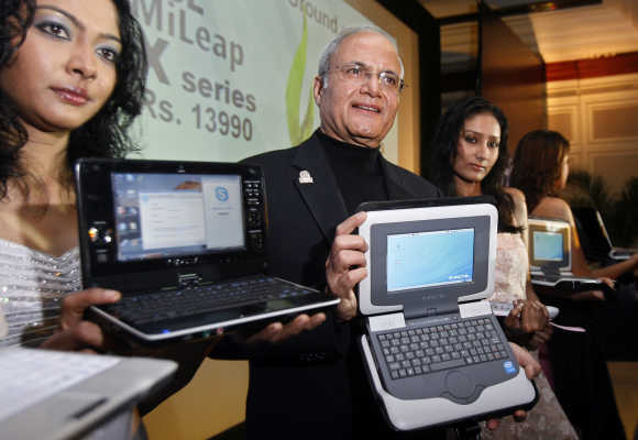 Ajai Chowdhry, Chairman and CEO, HCL Infosystems, displays HCL Mileap Y series laptop in a file photo.