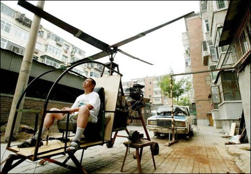A self-styled Chinese inventor tests his homemade helicopter next to his apartment in Beijing.