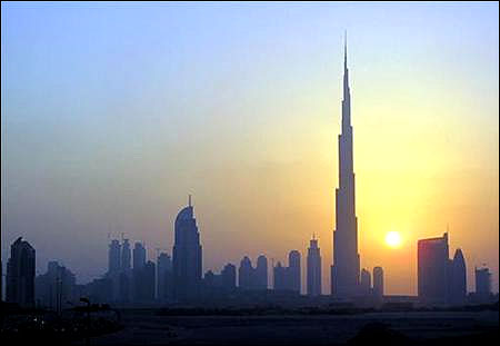 The Burj Khalifa (C) skyscraper is seen as the sun sets over Dubai.