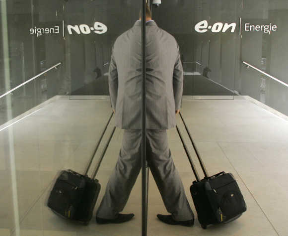 A reporter arrives for the annual news conference of the German E.ON Energie in Munich.