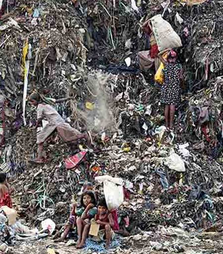 Children collect recyclable material at a dump in New Delhi.