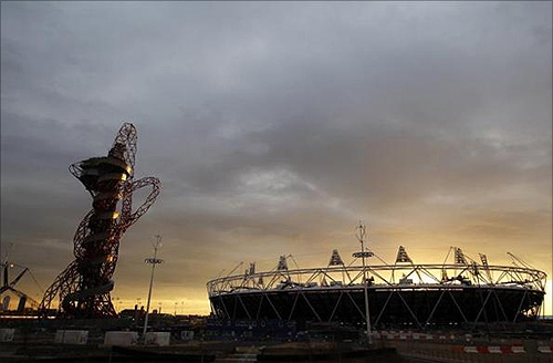Sun sets behind the Olympic stadium and Anish Kapoor's ArcelorMittal Orbit tower in Stratford, east London.