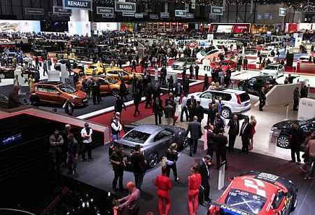 Visitors walk around booths during the 82nd Geneva Auto Show at the Palexpo Arena in Geneva