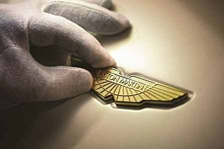 The 24 carat gold-plated Aston Martin wings logo