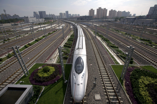 A CRH (China Railway High-speed) Harmony bullet train pulls into Beijing South Railway Station.